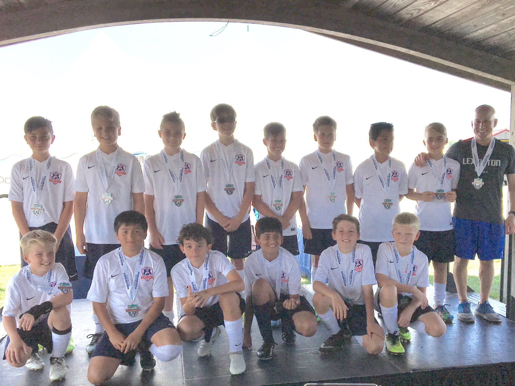Lexington FC 2005 Boys Red, Party on the Pitch Champions!